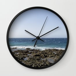 Waves on rocky shore Wall Clock