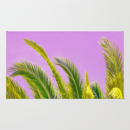 Green Palm Leaves On A Pink Background