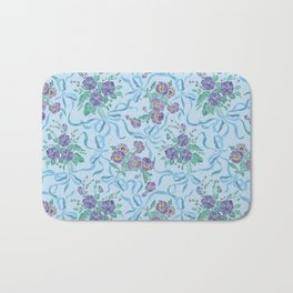 Violet with sweet peas flowers on sky-blue background Bath Mat