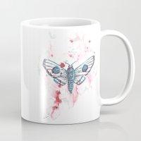 moth Mugs featuring Moth by Katré Eesmaa