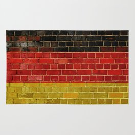 Germany flag on a brick wall Rug