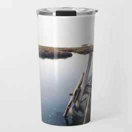 Weathered and rickety wooden dock almost collapsing in the Aveiro lagoon. Travel Mug
