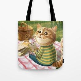 A cat is having a picnic Tote Bag