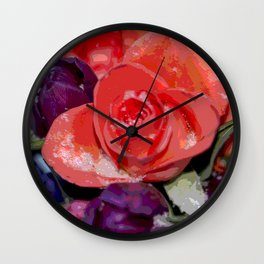 Snow settling on a top of Bouquet of flowers Wall Clock
