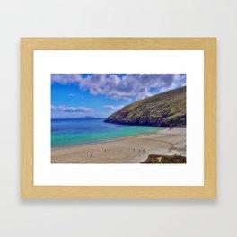 Walkers on Keem Beach, Achill Island feted by the green Atlantic Ocean. Framed Art Print
