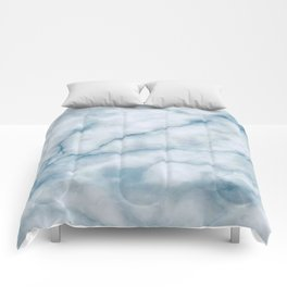 Light blue marble texture Comforters
