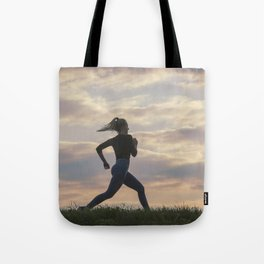 Running woman morning workout. Female Runner. Jogging during sunrise. Workout in a Park. Sporty Tote Bag