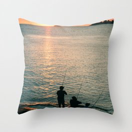 Three fisherman enjoy a beautiful sunset at the shore of 'Colonia del Sacramento, Uruguay'. Throw Pillow