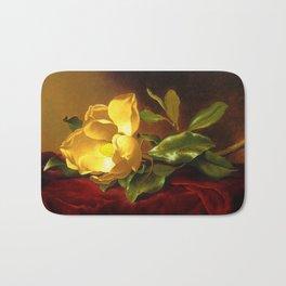 A Gold Yellow Magnolia on Red Velvet by Martin Johnson Head Bath Mat