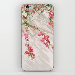 Sunkissed pink flowers on textured wall iPhone Skin