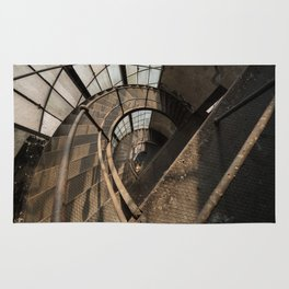 The world needs more spiral staircases. Abandoned power station. Rug