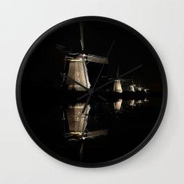 Floating illuminated windmills in the night Wall Clock