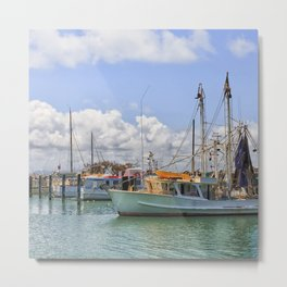 Boats moored on a river Metal Print