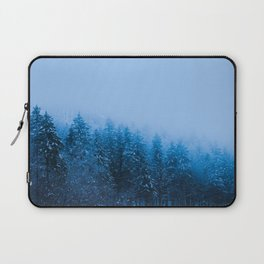 Fog over snow covered forest at lake Bohinj, Slovenia Laptop Sleeve