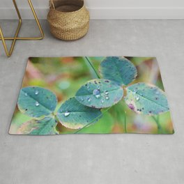 Clover leaves with rain drops Rug