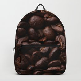 Dark roasted coffee beans arranged as flat background Backpack