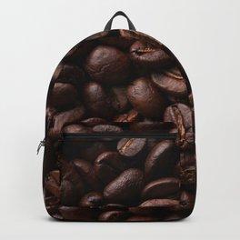 Dark roasted coffee beans arranged as flat background Backpack