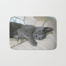 Grey Kitten Relaxed On A Bed  Bath Mat