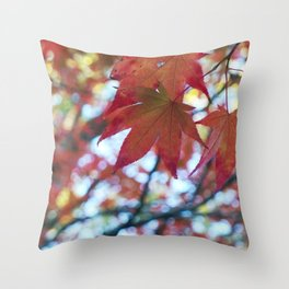 red maple leaves and bokeh Throw Pillow