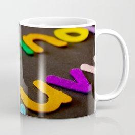 Closeup photo of assorted color alphabets Coffee Mug