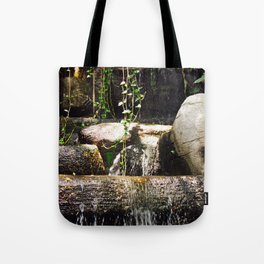 dreamy water flowing over old Asian stones Tote Bag