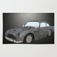 james bond Area & Throw Rugs featuring James Bond Aston Martin DB5 by Dany Delarbre