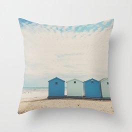 Charmouth beach huts Throw Pillow