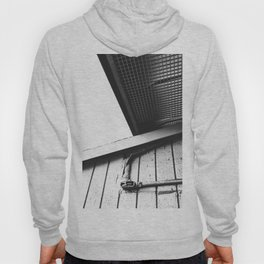 wood building in the city in black and white Hoody