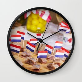II - Dutch herring ('haring') with onions and pickles on rustic table Wall Clock