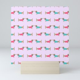 Cute dog lovers in pink background Mini Art Print