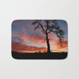 Beautiful Oak Tree In Colorful Southwestern Red, Yellow and Blue Sunrise Bath Mat