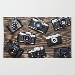 Collection of retro photo cameras on  wood Rug
