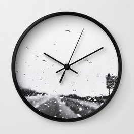 on the road in the rainy day in black and white Wall Clock