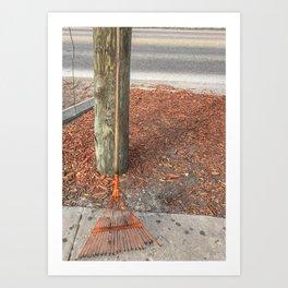 Rake against a pole Art Print