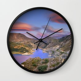 Lenticular clouds at the red sunset Wall Clock