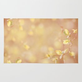 Many young spring leaves on blurred background Rug