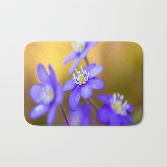 Spring Wildflowers, Beautiful Hepatica in the forest on a sunny and colorful background Bath Mat