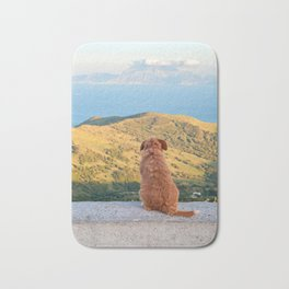 Lonely dog watching on Gibraltar Bath Mat