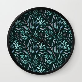 Branches with leaves on dark background Wall Clock