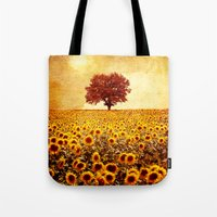 Tote Bags featuring lone tree & sunflowers field by Viviana Gonzalez