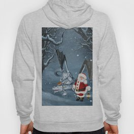 Santa Claus with ice dragon in a winter landscape Hoody