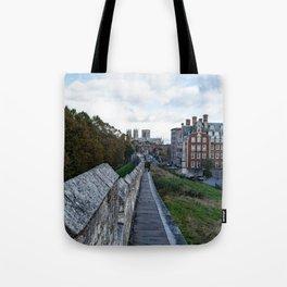 A walk along the wall Tote Bag