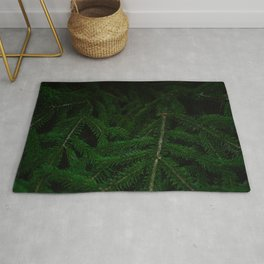 Pine Green Leaves In A Dark Surrounding Rug