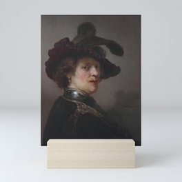 'Tronie' of a man with a feathered beret Mini Art Print
