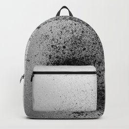 Black Spray Paint on Gray Backpack