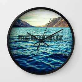 Love is like a lifeboat on the stormy sea of life. Wall Clock