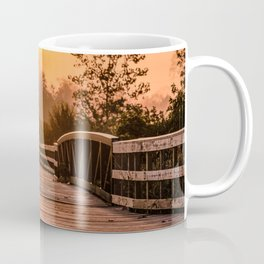 A beautiful sunrise view from a park footbridge Coffee Mug