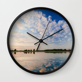 Cloudy Sky Reflecting In the Water at Sunset Wall Clock