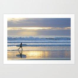Surfing at sunset Art Print