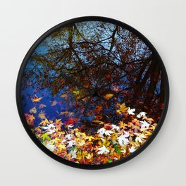 Maple Leaves floating on the Lake Reflecting Trees. Autumn, Fall Wall Clock